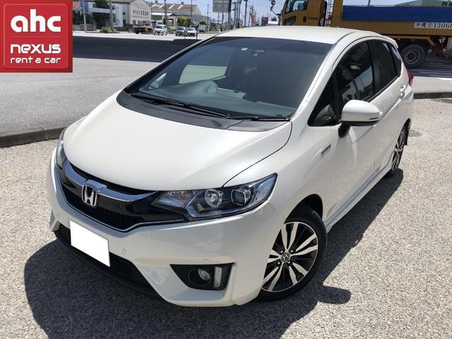 沖縄の中古車 ホンダ フィットハイブリッド 車両価格 135.4万円 リ済別 2016(平成28)年 3.2万km ホワイト