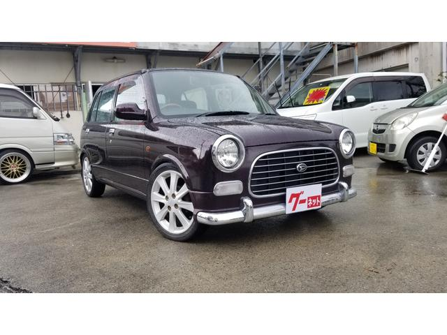 沖縄の中古車 ダイハツ ミラジーノ 車両価格 27万円 リ済込 平成11年 9.6万km ブラウン