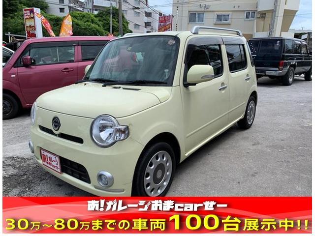 沖縄の中古車 ダイハツ ミラココア 車両価格 30万円 リ済込 2010(平成22)年 9.8万km イエロー