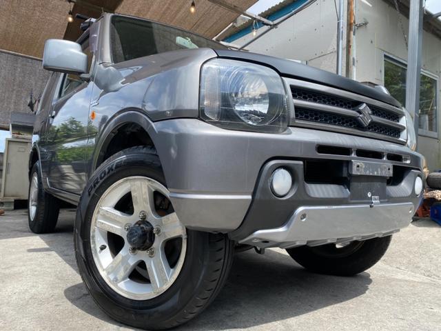 沖縄の中古車 スズキ ジムニー 車両価格 40万円 リ済込 2006(平成18)年 11.9万km ライトシルバー