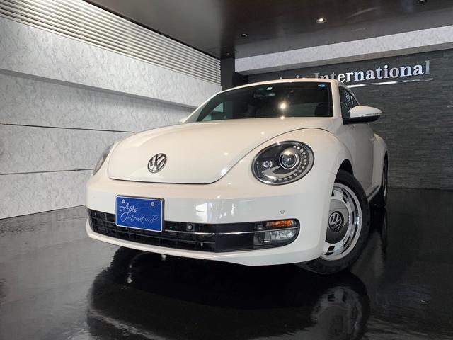 沖縄の中古車 フォルクスワーゲン VW ザ・ビートル 車両価格 180万円 リ済別 2014(平成26)年 1.9万km ホワイト