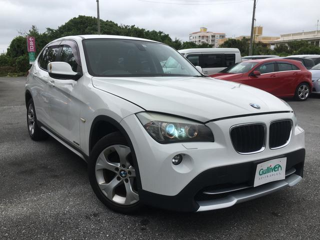沖縄の中古車 BMW X1 車両価格 99万円 リ済別 2011(平成23)年 5.6万km ホワイト