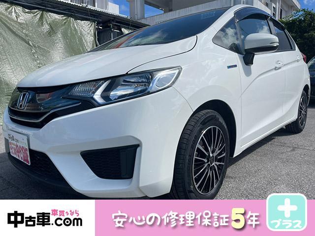 沖縄の中古車 ホンダ フィットハイブリッド 車両価格 67万円 リ済込 2015(平成27)年 8.5万km ホワイト