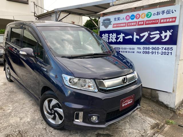 沖縄県の中古車ならフリードスパイクハイブリッド ジャストセレクション スマートキー HIDライト 両側パワースライドドア ETC フルセグナビ Bluetoothオーディオ バックカメラ 全席シートカバー装着車