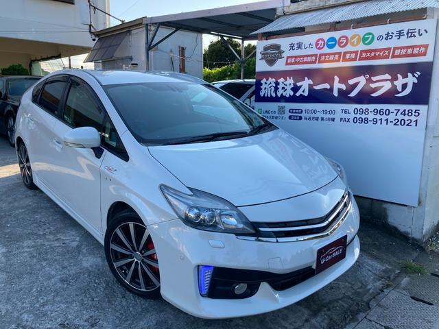 沖縄県の中古車ならプリウス Gツーリングセレクション スマートキー LEDヘッドライト メーカーOPナビ JBLサウンド フルセグTV Bluetoothオーディオ バックカメラ ETC 社外17インチアルミ TRDエアロ