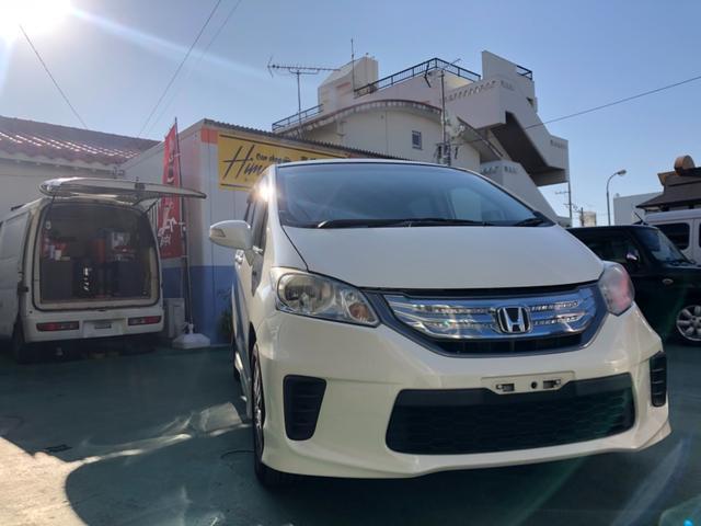 沖縄の中古車 ホンダ フリードハイブリッド 車両価格 85万円 リ済込 2012(平成24)年 9.7万km パールM