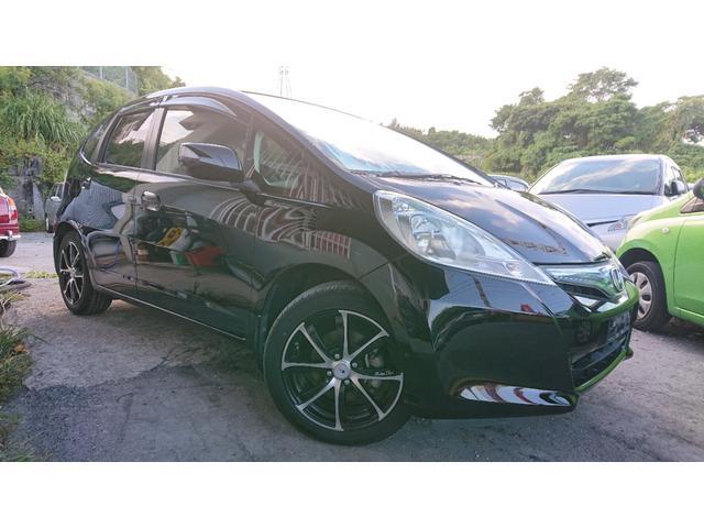 沖縄の中古車 ホンダ フィットハイブリッド 車両価格 53万円 リ済込 2012(平成24)年 7.0万km ブラック