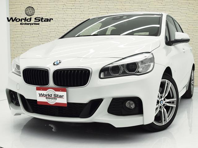BMW 225i xDriveアクティブツアラー Mスポーツ 18インチMライトダブルスポークスタイル486AW Rパークセンサー Bカメラ ブラックファブリックシート レザーステアリング インテリジェントセーフティ 自動防眩ミラー パワートランク パドルシフト