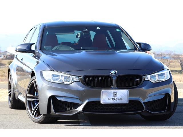 BMW M3 M3 法人1オーナー カーボンルーフ OP鍛造19AW コンフォートアクセス サキ―ルオレンジ・フルメリノレザー 純正HDDナビ Bカメラ インテリジェントセーフティ ACC Mヘッドアップディスプレイ