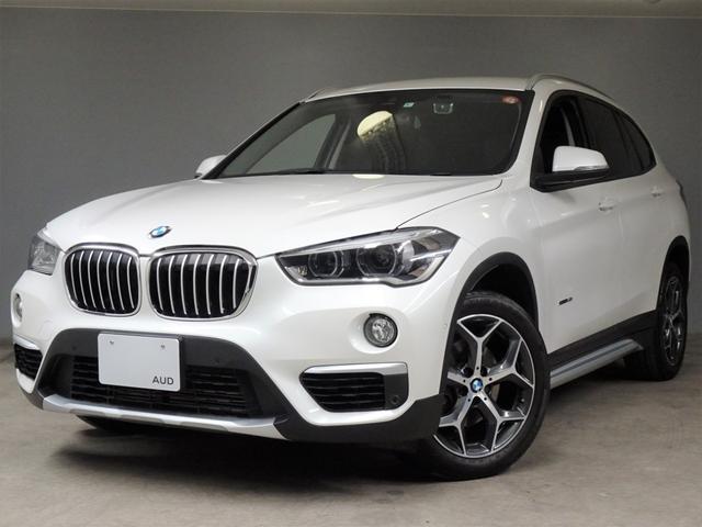 X1(BMW) sDrive 18i xライン 3気筒ターボEG 7速DCT 車検5年5月 コンフォートパッケージ ハイライン 黒レザー シートヒーター ウッドトリム 18インチアルミ 純正フロント&リアドラレコ ドアプロジェクターライト 中古車画像