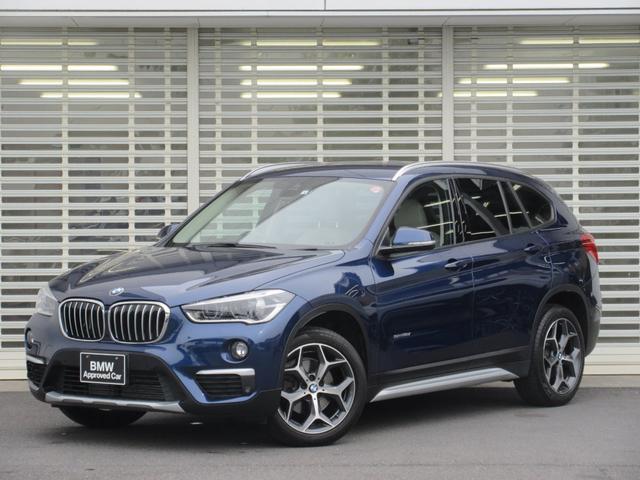 BMW X1 sDrive 18i xライン コンフォートパッケージ オイスターレザーシート 電動リアゲート ウッドパネル スライディングリアシート ドライビングアシスト パーキングアシスト 2.0ETCミラー 18インチアルミ リアフイルム