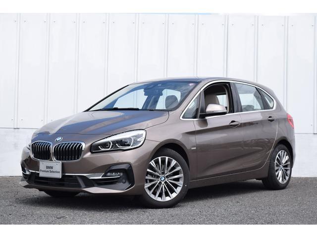 BMW 2シリーズ 218iアクティブツアラー ラグジュアリー 正規認定駐車 ワンオーナー 電動オイスターレザーシート シートヒーター 純正HDDナビ リアカメラ 前後障害物センサー 電動リアゲート コンフォートアクセス  SOSコール ドライバーアシスト ETC2.0