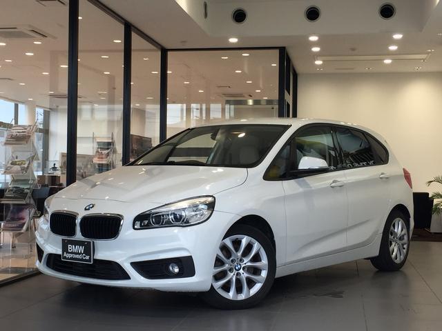 BMW 2シリーズ 218iアクティブツアラーセレブレションEDファッシ ベージュレザーシート コンフォートアクセス 電動トランク 純正17インチアルミ LEDヘッドライト シートヒーター バックカメラ リア障害物センサー 純正HDDナビ Bluetooth&USB接続可