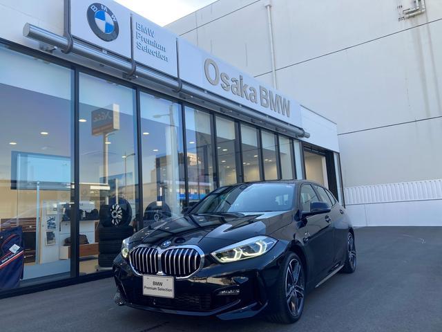 BMW 118i Mスポーツ 弊社デモカー・新車保証継承・ナビゲーションパッケージ・コンフォートパッケージ・電動リアゲート・アクティブクルーズコントロール・ドライビングアシスト・パーキングアシスト
