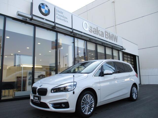 BMW 218dグランツアラー ラグジュアリー 弊社下取ワンオーナー・7人乗り・ブラックレザーシート・コンフォートパッケージ・電動リアゲート・純正HDDナビ・バックカメラ・衝突軽減ブレーキ・車線逸脱システム・認定中古車・全国保証