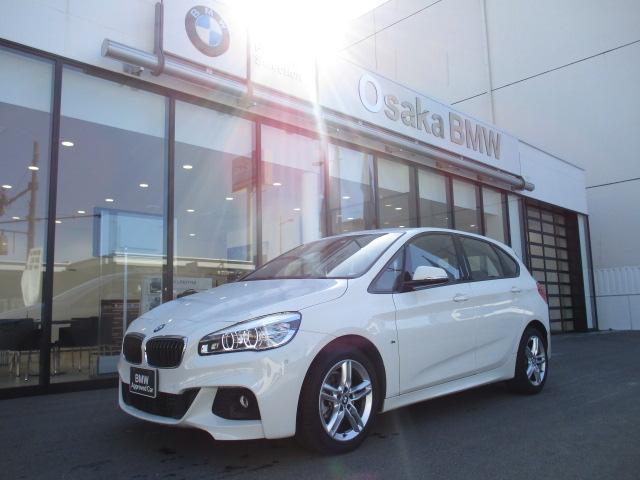 BMW 218iアクティブツアラー Mスポーツ 弊社下取り車輛・アクティブクルーズコントロール・ヘッドアップディスプレイ・電動リアゲート・ブラックレザーシート・コンフォートアクセス・パーキングサポートパッケージ・前後PDC・純正HDDナビ・全国保証