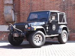 クライスラージープ ラングラースポーツ正規D車 ミッキートンプソンAW カスタムバンパー