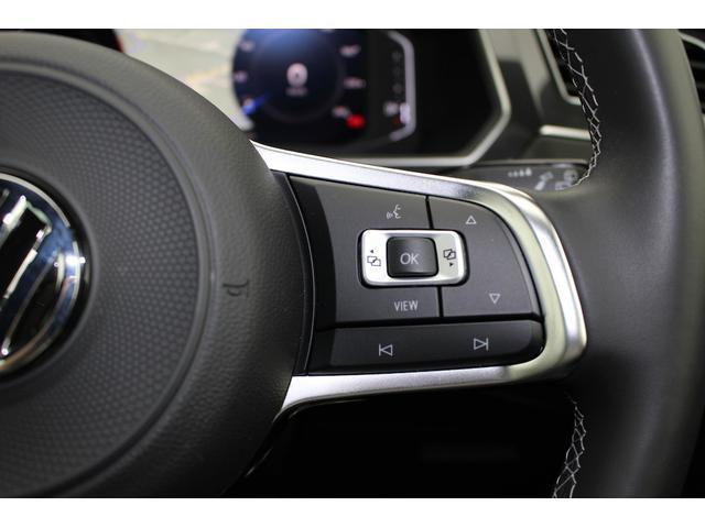ステアリング右手側のメーター中央のマルチファンクションインジケーターの操作スイッチ