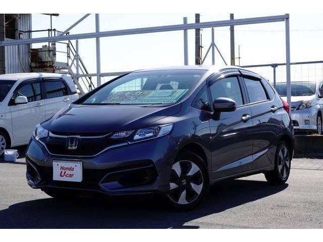 沖縄の中古車 ホンダ フィットハイブリッド 車両価格 182.8万円 リ済別 平成29年 0.8万km グレーメタリック