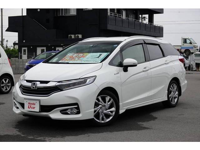 沖縄の中古車 ホンダ シャトル 車両価格 219.8万円 リ済別 平成30年 1.3万km ホワイトパール