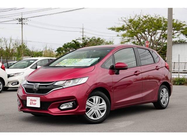 沖縄の中古車 ホンダ フィット 車両価格 136.8万円 リ済別 2018(平成30)年 0.7万km レッドメタリック