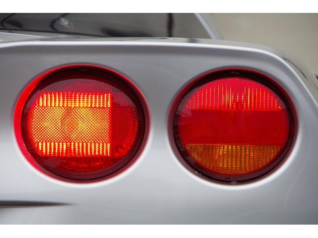 ベースグレード 社外マフラー ベージュレザー ナビ TV SD バックカメラ スマートキー パワーシート シートヒーター クルーズコントロール HIDヘッドライト ETC BOSEサウンドシステム タルガトップ(19枚目)