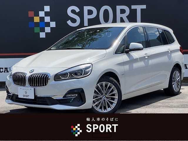 BMW 2シリーズ 218dグランツアラー ラグジュアリー 黒革 シートヒーター・メモリー パワーバックドア 純正HDDナビ バックカメラ コンフォートアクセス LEDヘッドライト Bluetooth 純正アルミホイール ミラーインETC 3列シート