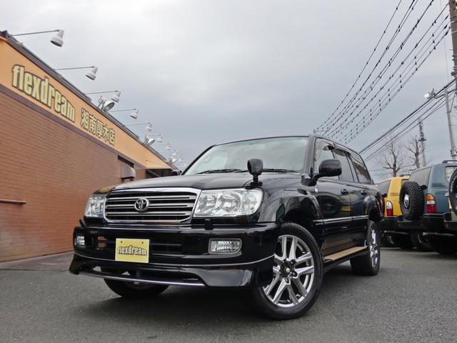 トヨタ ランドクルーザー100 VXリミテッド ブラックカスタム済みランクル100 シートカバー 20インチアルミ ナビ
