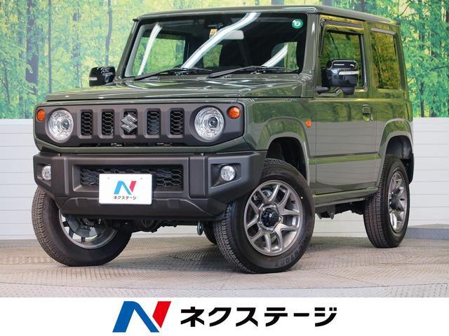 スズキ XC 届出済未使用車 ETC セーフティサポート 4WD ターボ LEDヘッドランプ クルーズコントロール 純正16アルミ シートヒーター ドアバイザー 革巻きステアリングホイール