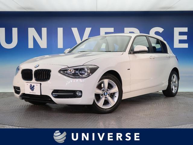 BMW 1シリーズ 116i スポーツ スポーツシート 純正HDDナビ 純正16インチAW デュアルオートエアコン レッドステッチ入インテリア HIDヘッドライト オートヘッドライト 禁煙車 ETC