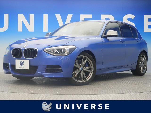 1シリーズ(BMW) M135i 自社買取車両 最出力320Ps 純正HDDナビ バックカメラ パーキングサポートパッケージ ドライビングアシストパッケージ 純正18インチAW キセノンヘッドライト パワーシート 中古車画像