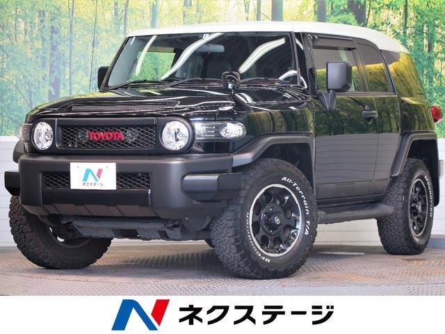 トヨタ ブラックカラーパッケージ 社外SDナビ バックカメラ クルーズコントロール 4WD オールテレーンタイヤ 専用17インチアルミ コーナーセンサー 革巻きステアリングホイール ETC プライバシーガラス
