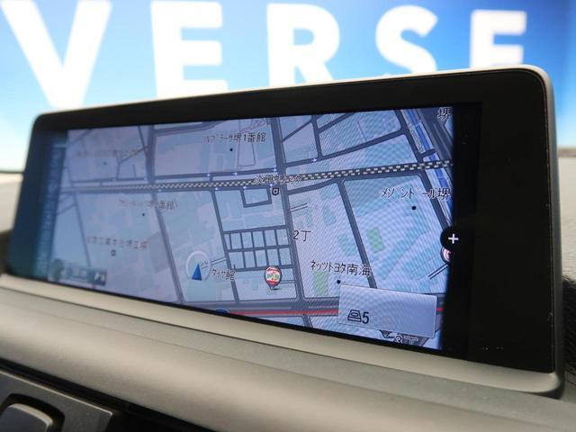 116i スポーツ 純正HDDナビ バックカメラ ETC TVチューナー HIDヘッドライト オートライト 純正16インチAW 前席スポーツシート(レッドステッチ入り) デュアルオートAC リアパークソナー(6枚目)