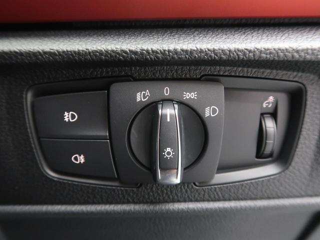 116i スポーツ 純正HDDナビ バックカメラ ETC TVチューナー HIDヘッドライト オートライト 純正16インチAW 前席スポーツシート(レッドステッチ入り) デュアルオートAC リアパークソナー(50枚目)
