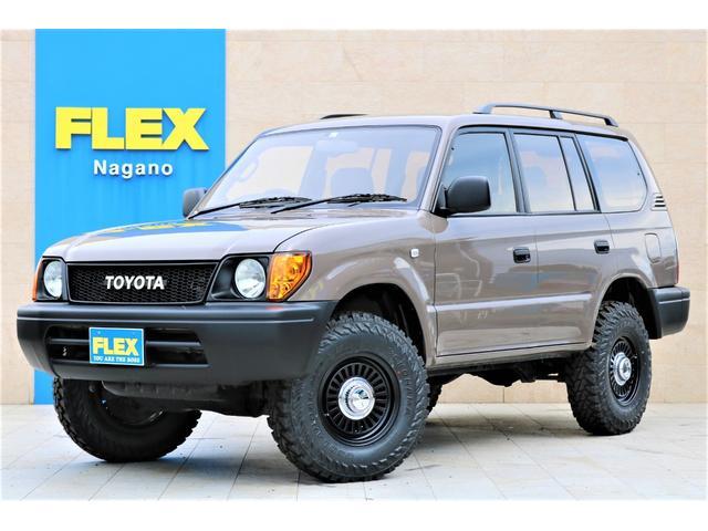 トヨタ TXリミテッド レザー調シートカバー DEANカリフォルニア16インチAW ジオランダー235MTタイヤ TOYOTAロゴグリル LEDテールランプ 内張メキシカンラグ張替え