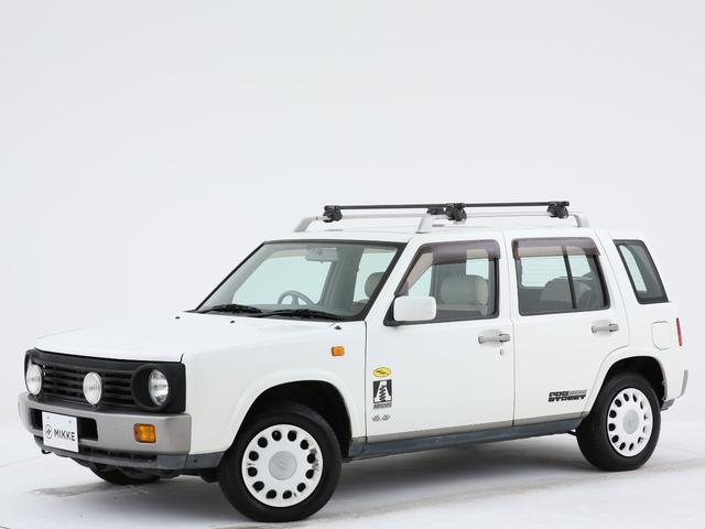 日産 ラシーン タイプL ユーザー買取車両 / 丸目カスタム / チェック柄フロアマット / 白塗装スチールホイールキャップ / 4速AT / ABS