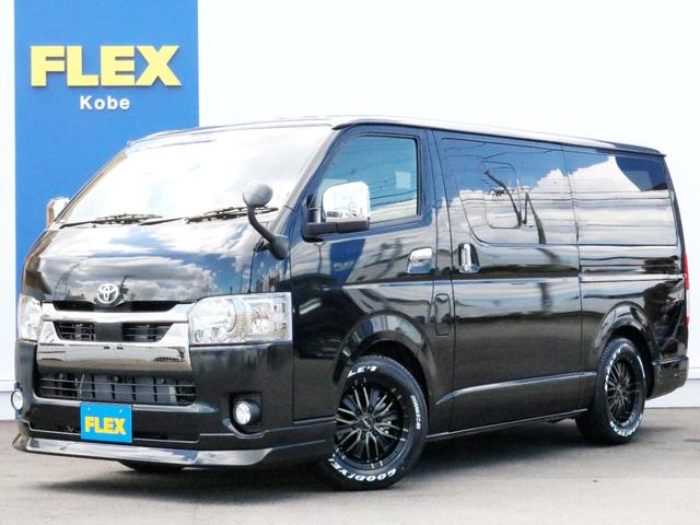 トヨタ スーパーGL ダークプライムII ハイエースバンBIG-Xパッケージ FLEXフロントリップ MF01AW ナスカーホワイトレタータイヤ BIG-X11インチフルセグSDナビ FLEXベッドキットType2フラット車中泊対応 ETC