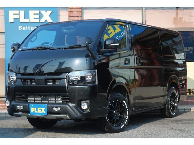 トヨタ スーパーGL ダークプライムII BLACKシリーズインナーブラックヘッドライトTRDバンパーガードLEDミラーウィンカーLEDテールライト煌REDオリジナルベットキットタイプ2ストラーダフルセグSDナビビルドインETC