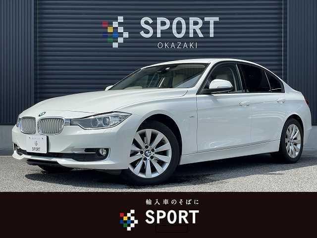 BMW ◆320d モダン ベージュレザー シートメモリー・ヒーター 純正HDDナビ バックカメラ パドルシフト HIDヘッドライト CD DVD Bluetooth ETC 純正アルミホイール