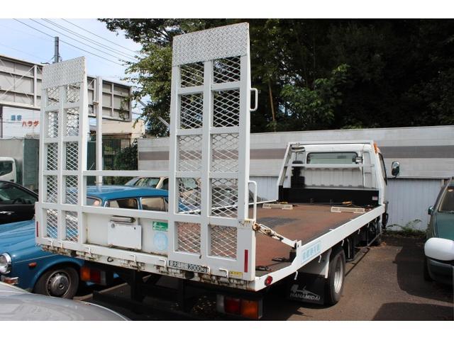 自社積載車も完備しております納車引取もお任せください。