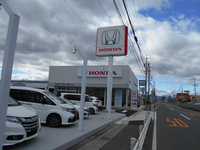 HondaCarsの看板が目印!