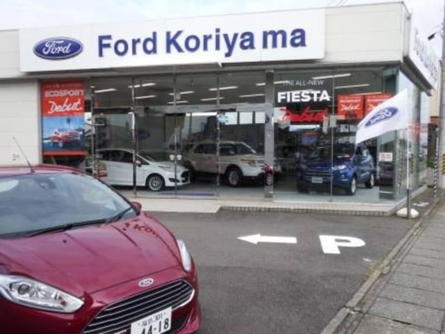 国道49号線沿い、東北新幹線高架橋の下にお店はございます。FORDの青いエンブレムが目印です。